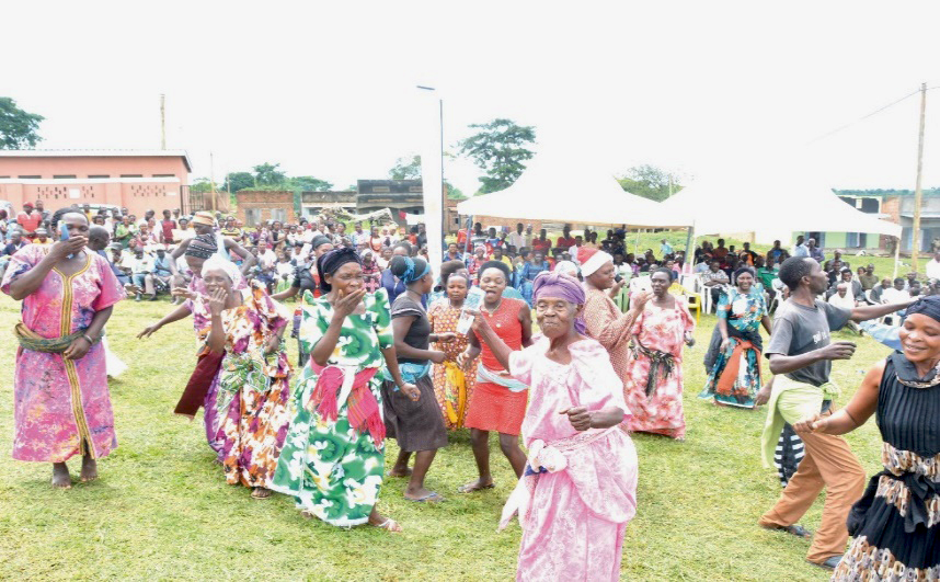 In Golomolo, Uganda, women celebrate victory after Buganda Land Board helped them have a fraudulent land title canceled. (Photo by Kimbowa Joseph / Buganda Land Board)
