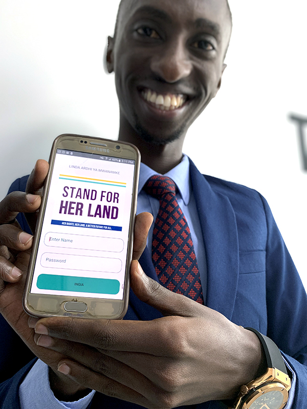 Showing the Stand For Her Land section on the Law On Your Palm phone app